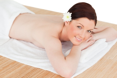 Portrait of an attractive serene woman posing while relaxing in a spa centre photo