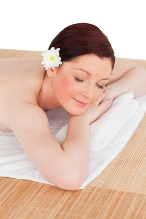 Portrait of a good looking serene woman posing while relaxing in a spa centre photo