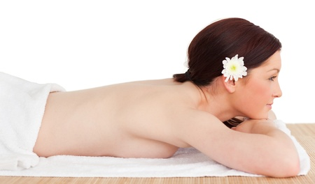 Portrait of a cute serene woman posing while relaxing in a spa centre photo