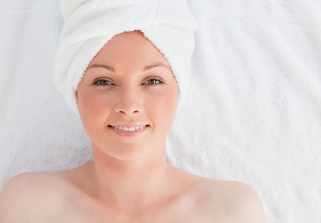 Closeup of a pretty serene woman posing while relaxing in a spa centre photo