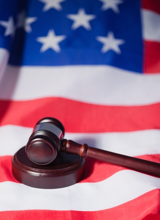 US flag and brown gavel photo