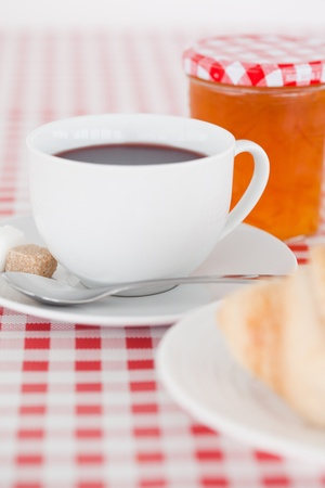 Continental breakfast with croissant, jam and coffee on a tablecloth Stock Photo - 10198711