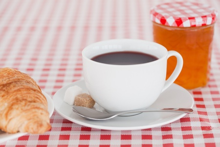 Continental breakfast with croissant, jam and coffee on a tablecloth Stock Photo - 10206035