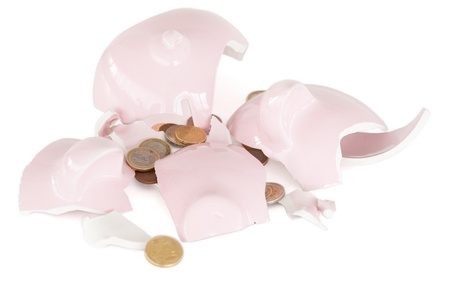 Broken piggy savings bank against a white background photo