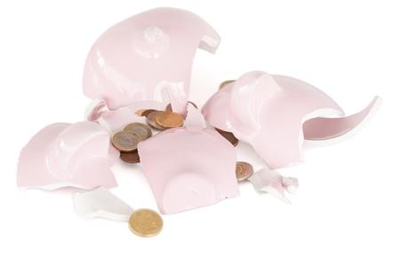 Broken piggy savings bank against a white background Stock Photo - 10192895