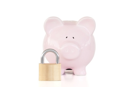 Pink piggy bank and padlock against a white background. Stock Photo - 10192544