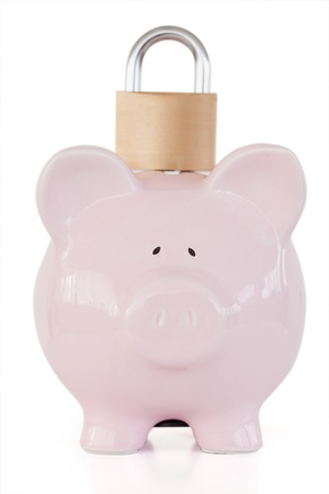 Front view of pink piggy bank and padlock against a white background.  photo