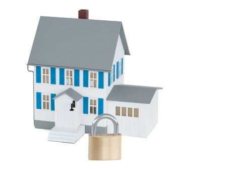 Secured grey house against a white background Stock Photo - 10192842