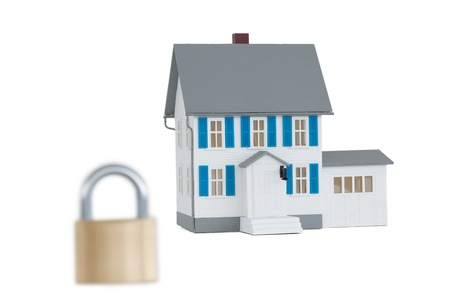 House locked with padlock against a white background  photo