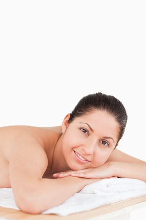 dark-haired young woman on a table in a spa photo