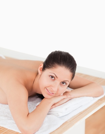 dark-haired woman in a spa smiling photo
