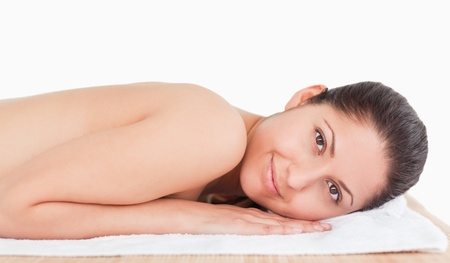 smilling young woman in a spa on a massage table photo