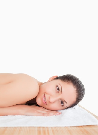 Smilling young woman on a towel white background photo