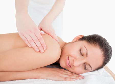 young woman having a massage in a spa photo