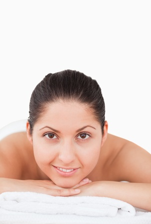 beautiful woman in a spa smiling at the camera photo