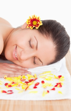 brunette and flowers petals in a spa photo