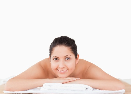 young woman in a spa smilling at the camera photo