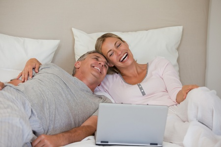 Lovely couple looking at their laptop photo