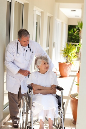 Senior doctor talking with his patient photo