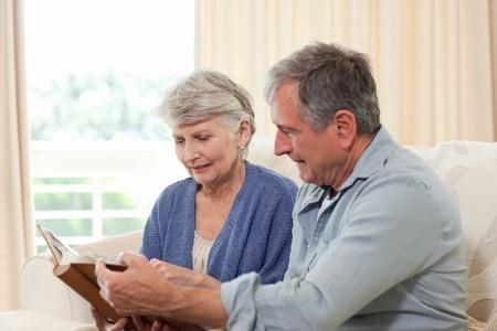 Seniors looking at their photo album Stock Photo - 10197520
