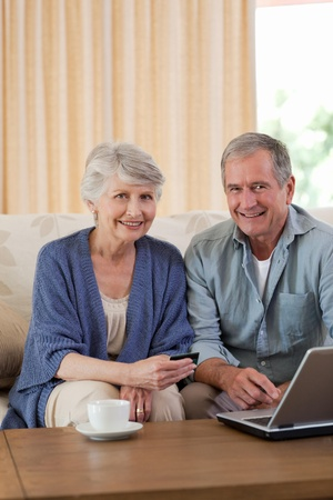 Retired couple looking at their laptop photo