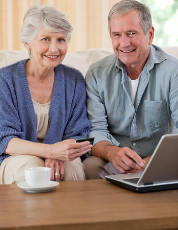 Retired couple looking at their laptop Stock Photo - 10196206