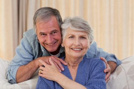 Mature man hugging his wife photo