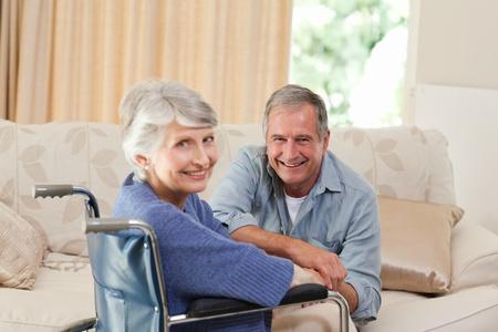 amputation: Mature couple looking at the camera Stock Photo