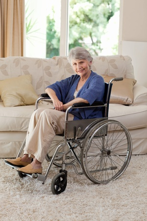 Retired woman in her wheelchair photo