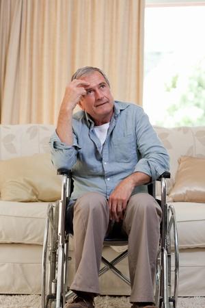 Senior man in his wheelchair photo