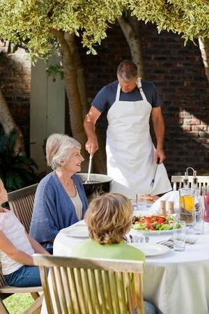 Family eating in the garden Stock Photo - 10198373