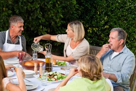 Lovely family eating in the garden Stock Photo - 10198251