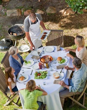 Lovely family eating in the garden photo