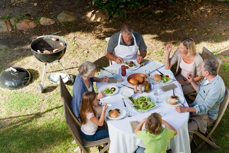 Adorable family eating in the garden Stock Photo - 10207006