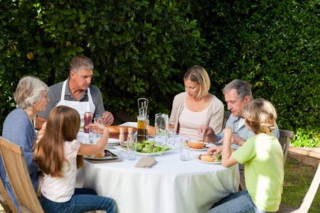 Adorable family eating in the garden Stock Photo - 10198903