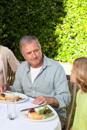 Adorable family eating in the garden Stock Photo - 10198133