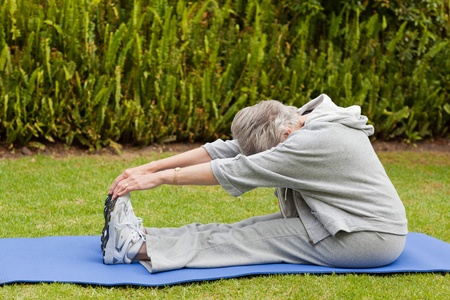 Senior woman doing her streches Stock Photo - 10206424