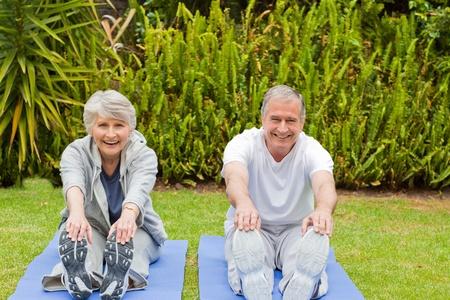 Senior couple doing their streches Stock Photo - 10205981