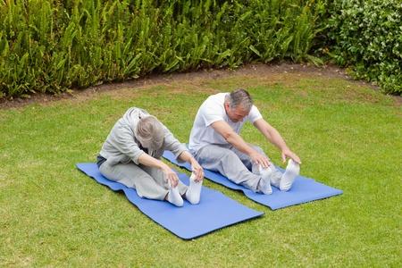 Senior couple doing their streches Stock Photo - 10206889