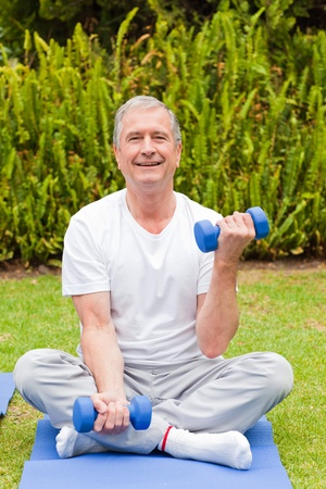 Retired man doing his exercises in the garden Stock Photo - 10198672