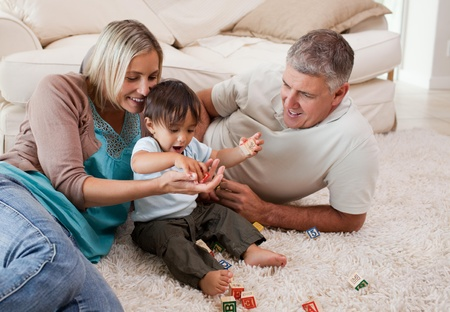 Son playing with his parents Stock Photo - 10197490
