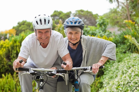 Mature couple mountain biking outside photo
