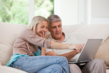 Couple looking at their laptop photo