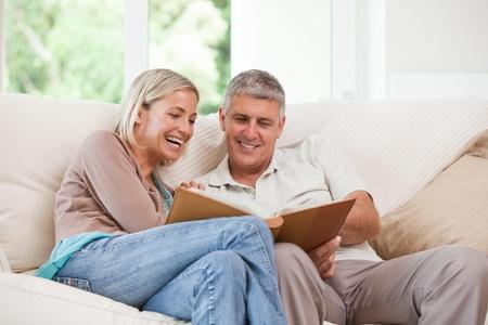 Couple looking at their photo album Stock Photo - 10197637