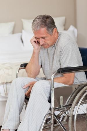 Thoughtful senior man in his wheelchair   photo