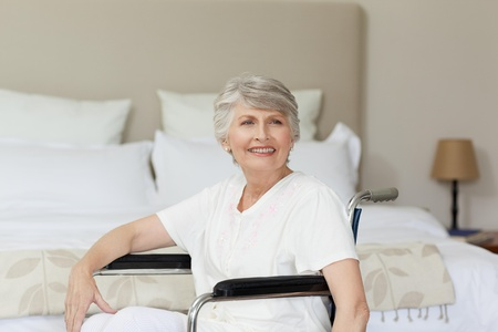 Smiling senior woman in her wheelchair photo