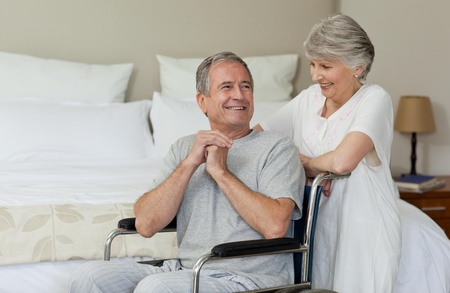 amputation: Mature couple in their bedroom