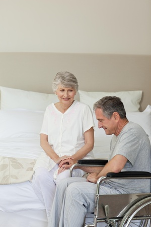 Mature couple in their bedroom photo
