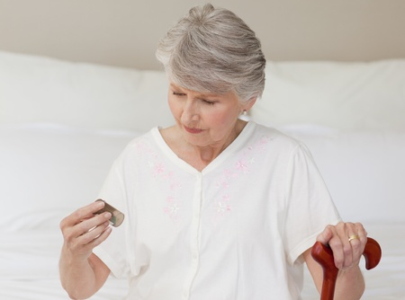 Sick senior woman taking her pills Stock Photo - 10193109