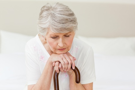 nursing homes: Retired woman with her walking stick  Stock Photo
